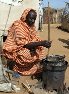 Darfur stove in use by Halima