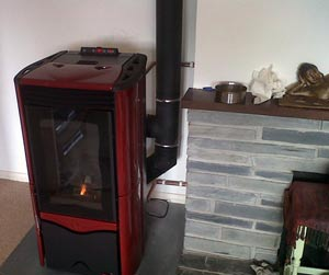 Extraflame duchessa wood pellet boiler stove being installed